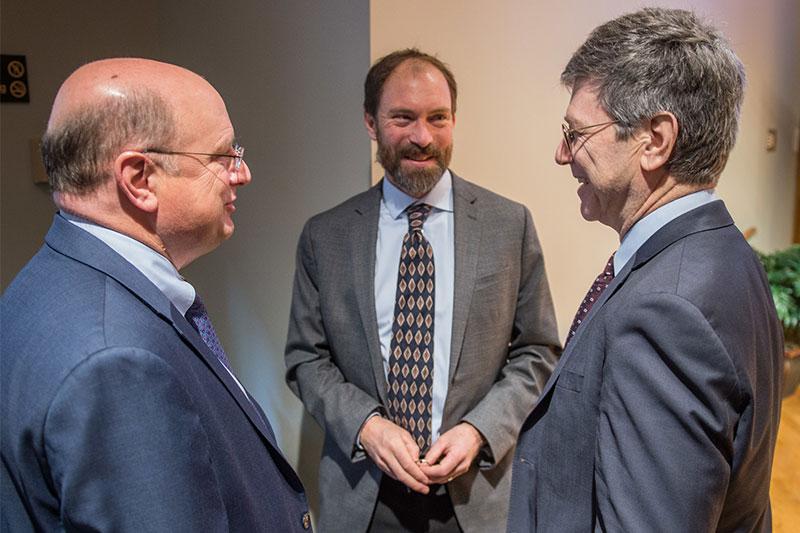 Beatty (center) talks with Keough School Dean Scott Appleby and Jeffrey Sachs