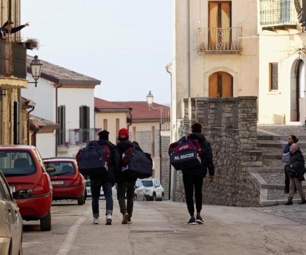 Migrants in Bisaccia's SPRAR return home from a soccer match